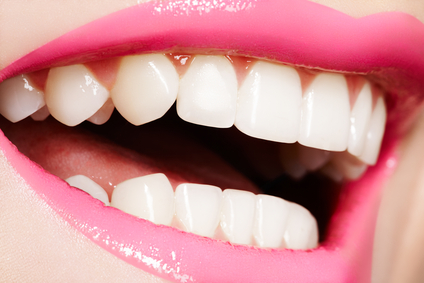 Macro happy woman's smile with healthy white teeth, bright gloss lips